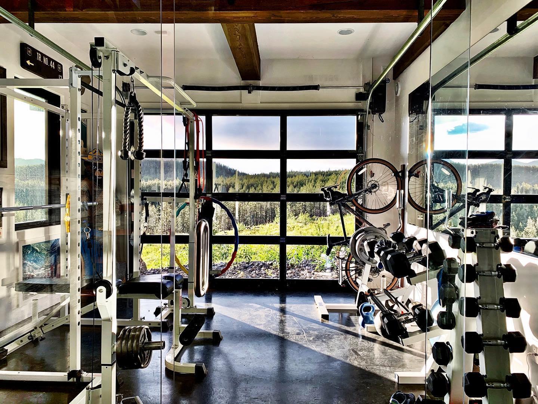 Home gym + Garage Door @theoverheaddoor whitefish custom home builder