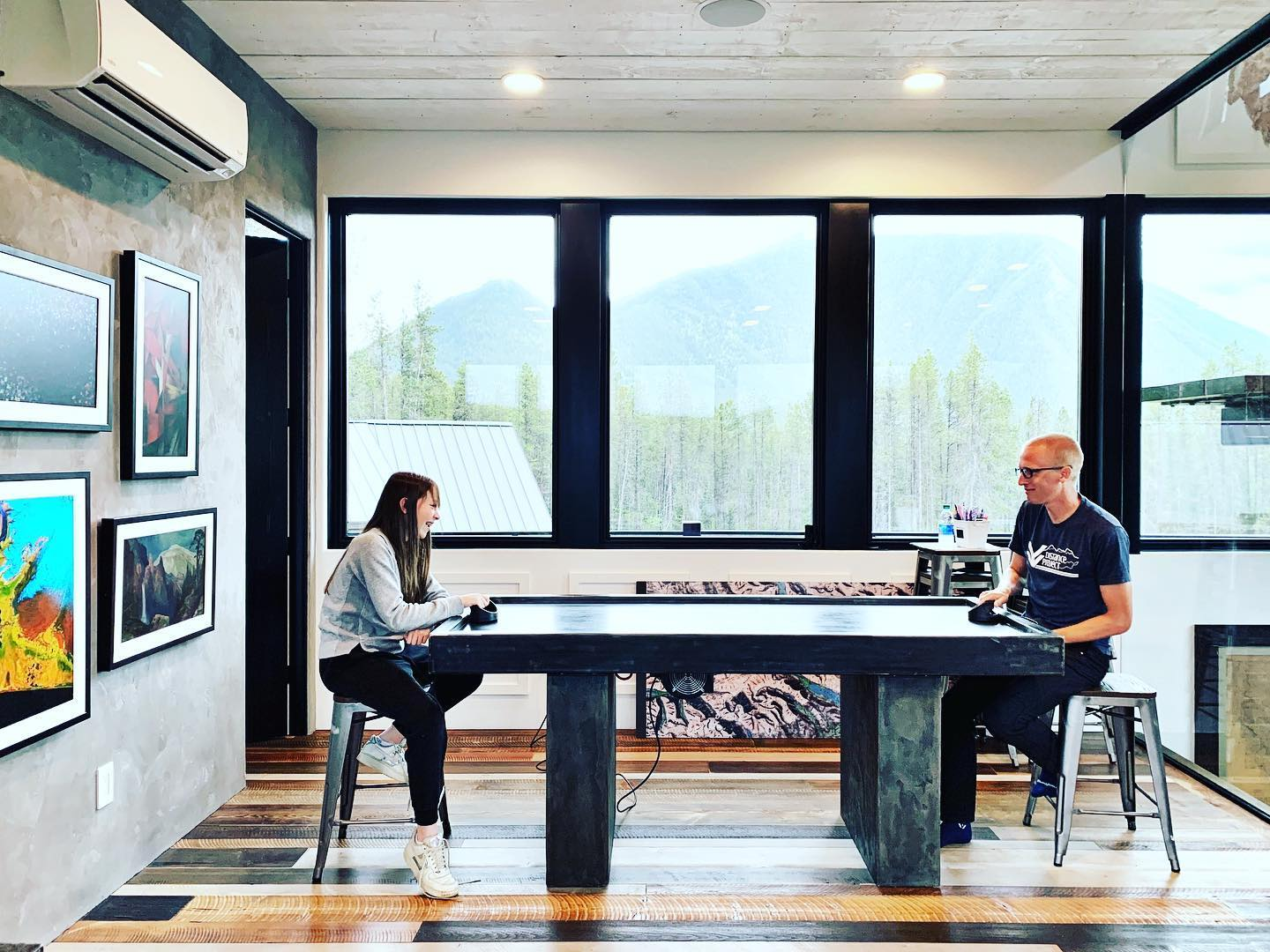Because every house needs an air hockey table whitefish custom home builder