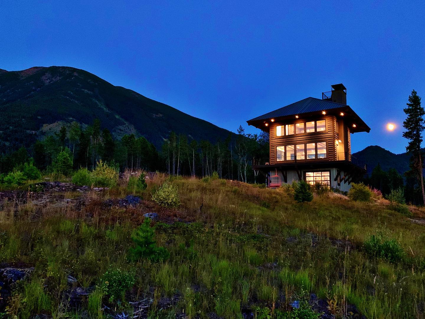 """Summer nights! One of the many reasons I believe in """"accent lighting"""" whitefish custom home builder"""