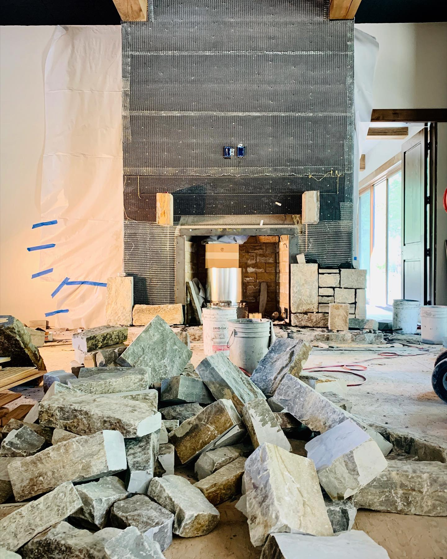 Are these rocks big enough for this fireplace?!? whitefish custom home builder
