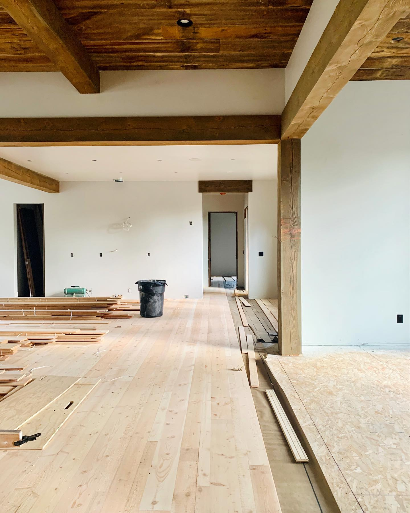 Flooring is always such a house changer...and a sneak preview to these amazing reclaimed barn wood ceiling! whitefish custom home builder