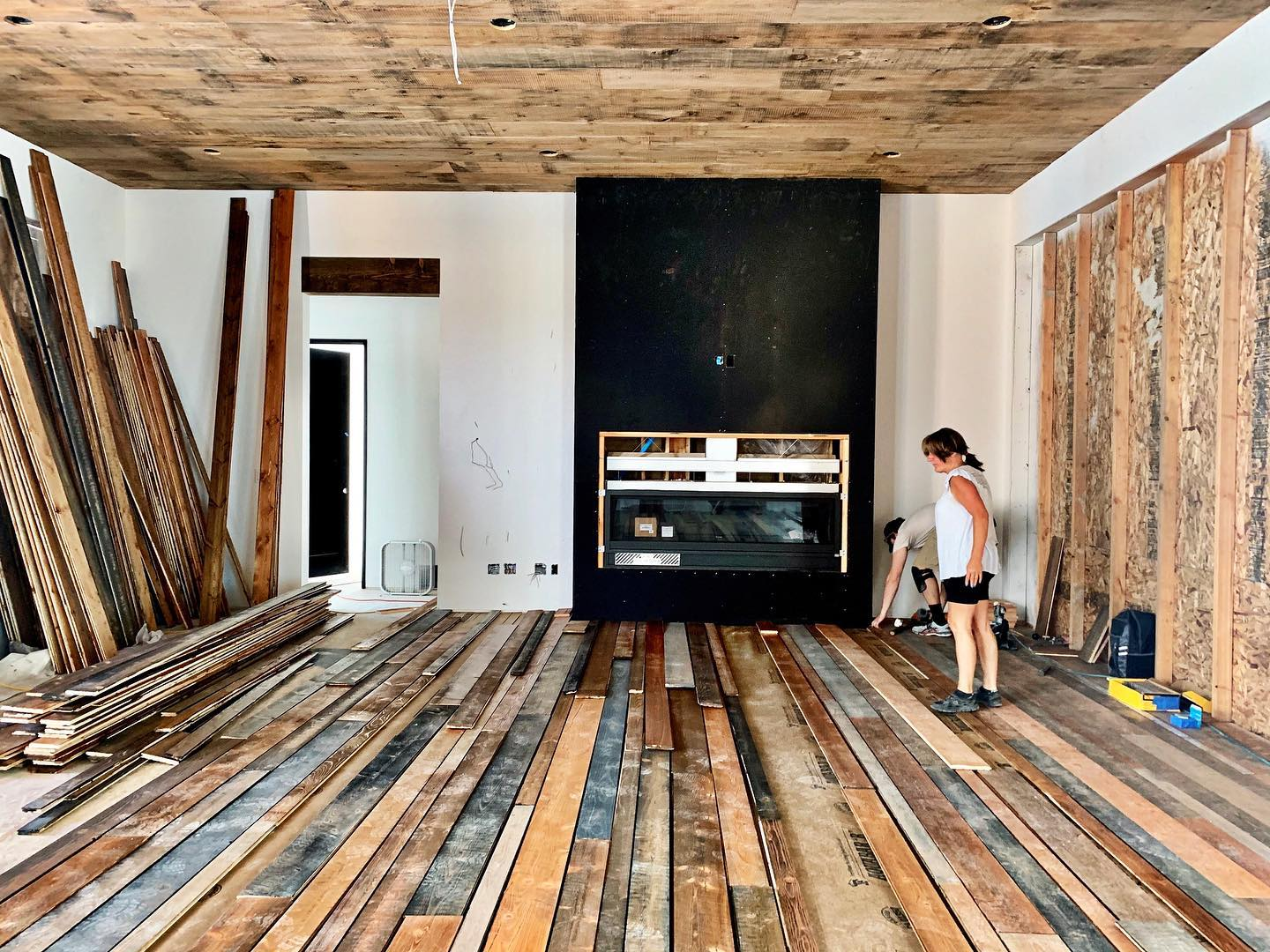 """It's always hard to post an """"in progress photo"""" but I am so excited about this floor! In 3 days our little team, including the homeowner) stained 3,000 square feet. It's going to be a show piece!! whitefish custom home builder"""