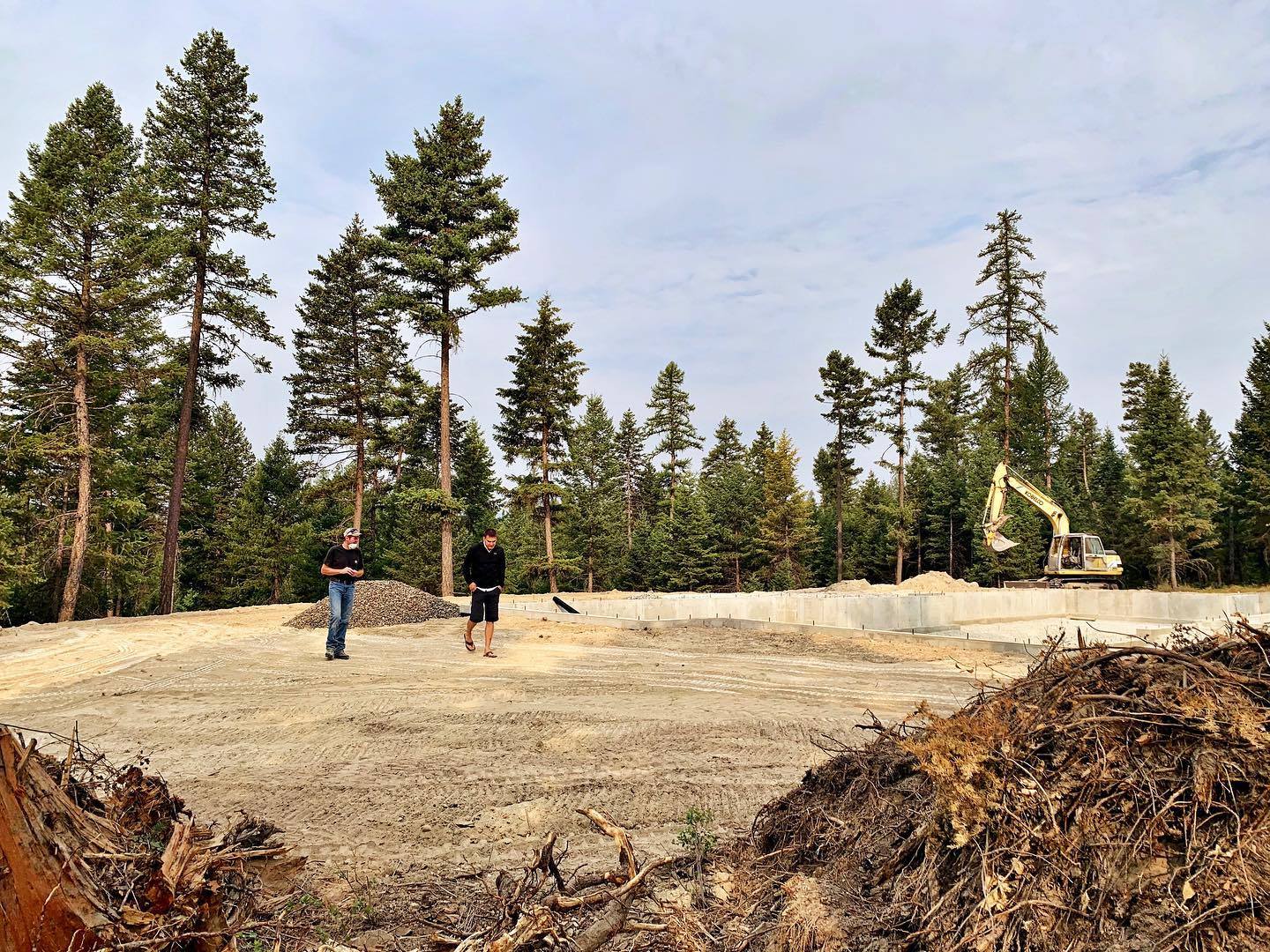 Backfilling (something about this reminds me of a moonscape!) whitefish custom home builder