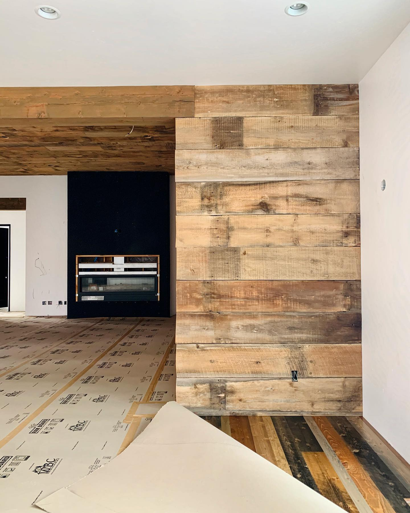 Reclaimed wood and our own version of a new-reclaimed floor which turned out fantastic. We love it!! whitefish custom home builder