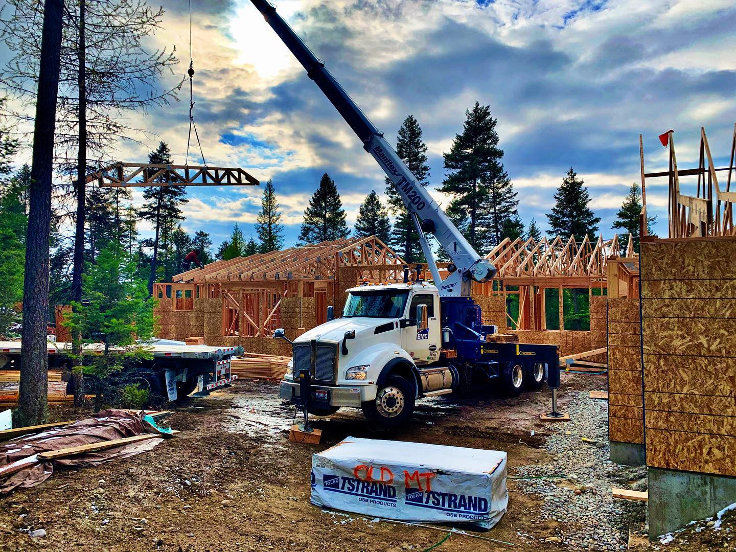 Truss setting day is always a good day! whitefish custom home builder