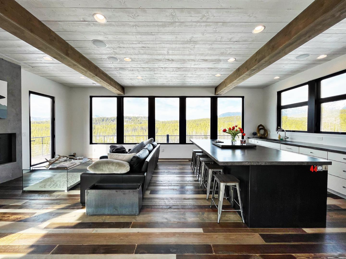 This space is only 28 x 28 feet, but context to how large rooms can live if they designed right! And of course, the windows really help! @cmtfabrication @awiwoodworks whitefish custom home builder