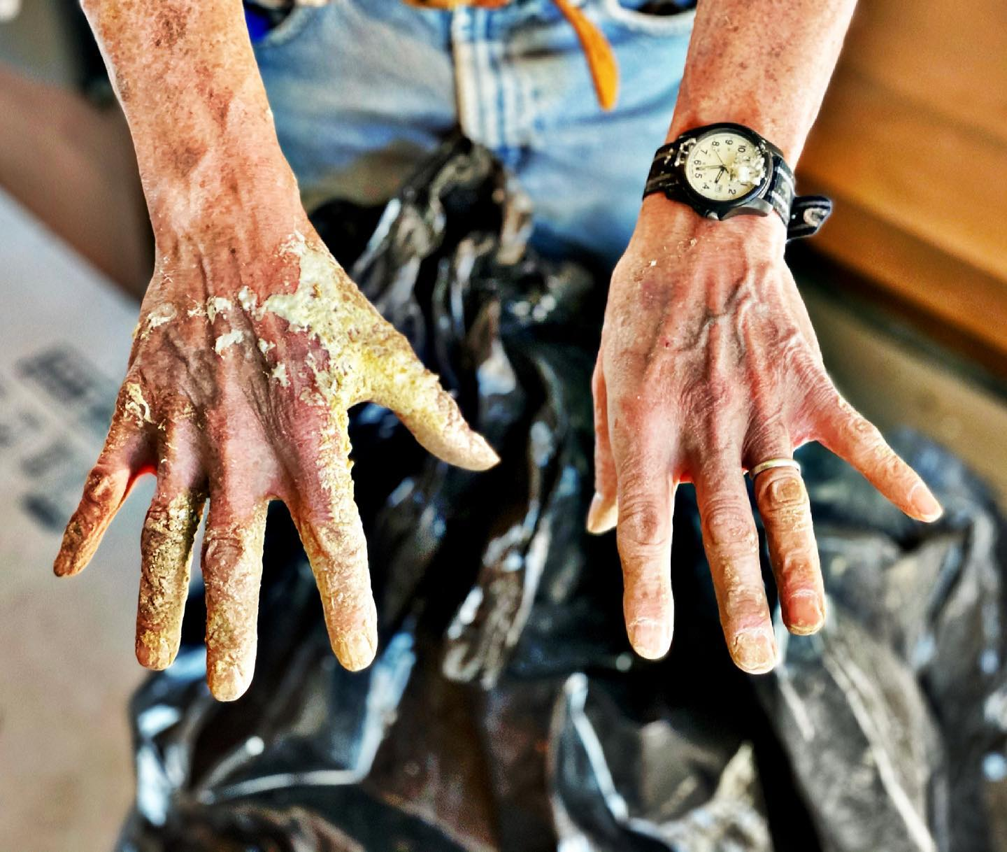 My Dad's jobsite hands...he's never afraid to tackle any job I ask him to, and I'm lucky he's not a skin diva  we aren't quite sure how this is going to come off! whitefish custom home builder