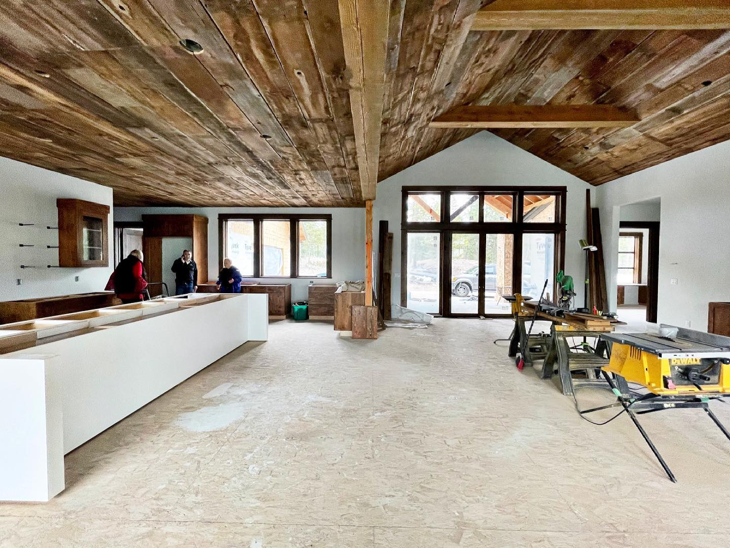 Joe has been working all week to get this barn wood up...it covers the kitchen, dining, and great room, and follows the hallway to the bedroom and mudrooms. It looks amazing! @oldmontanabuilding whitefish custom home builder