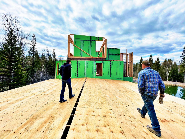 Roof walking whitefish custom home builder