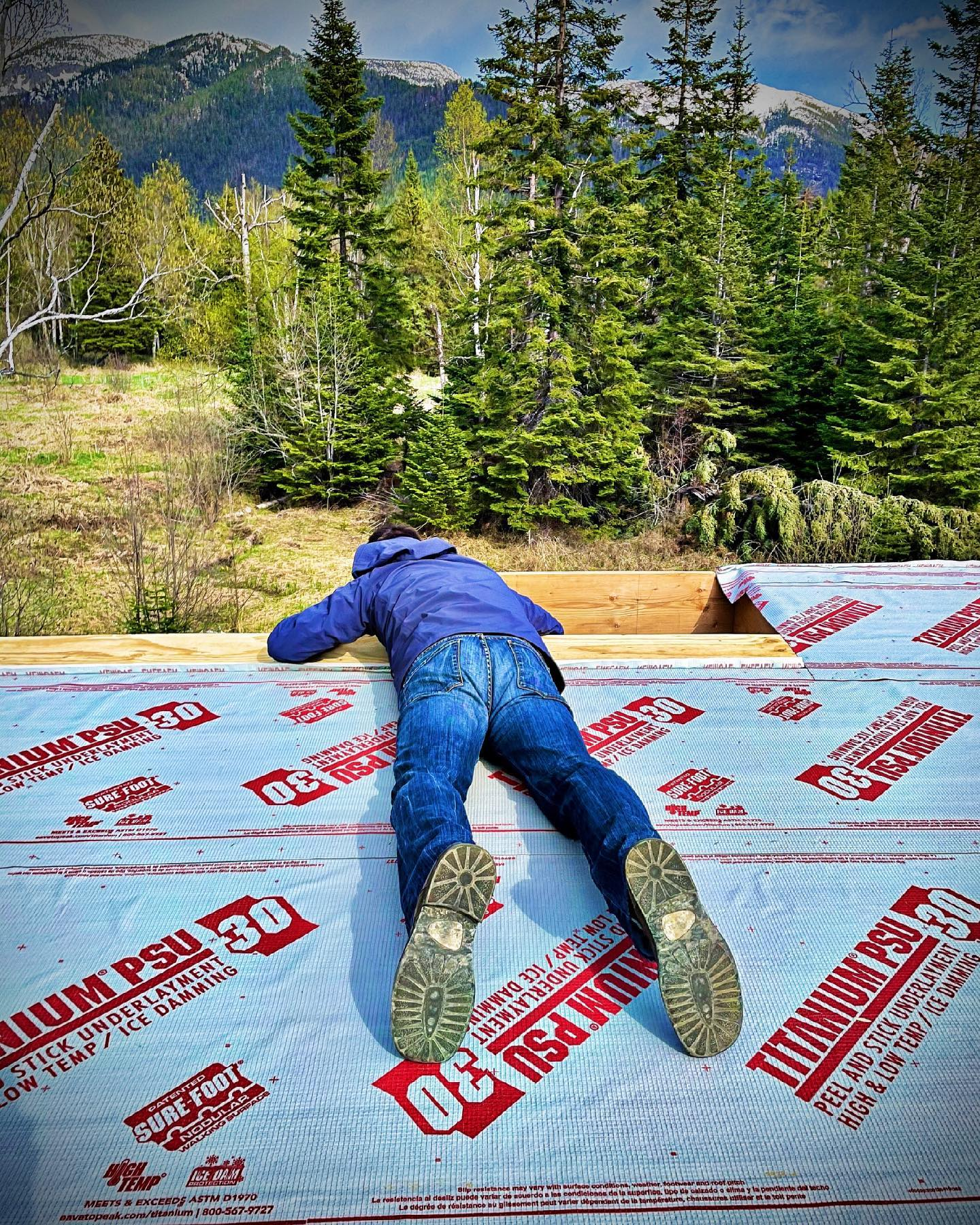 Builder shot of the day...checking out the roof line whitefish custom home builder