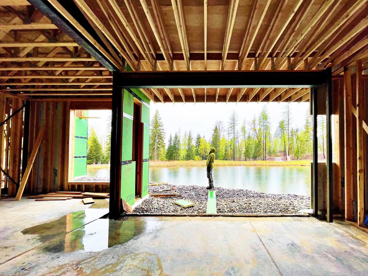 We could almost float out of this house today in this rain...but instead we are looking at how to set these massive windows. The project of the next 2 weeks! whitefish custom home builder