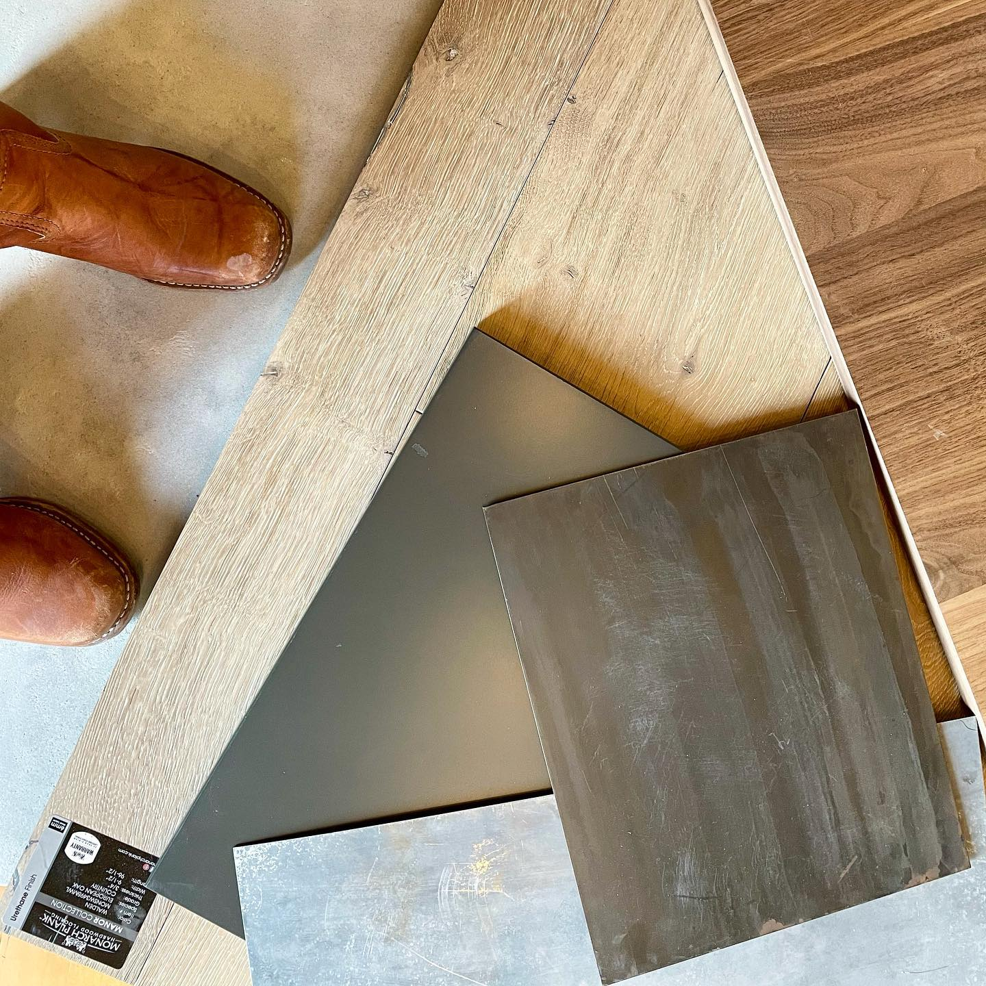 Color pallet of the day...whitewashed oak flooring, iron ore and rustic walnut cabinets, gun-blued steel hood, zinc countertops (and Frye boots ) @awiwoodworks @cmtfabrication whitefish custom home builder
