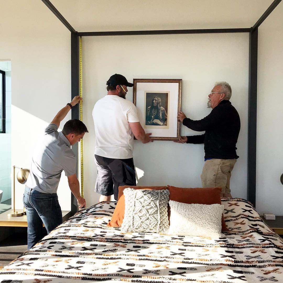 It takes 3 men to hang an original Curtis (Love Love Love) whitefish custom home builder