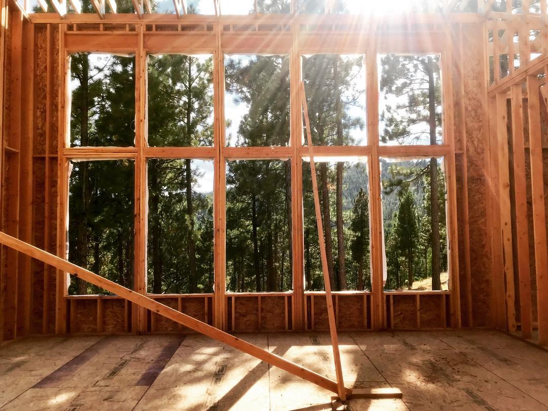 Window wall. This house makes it feel like you are living in the trees! whitefish custom home builder