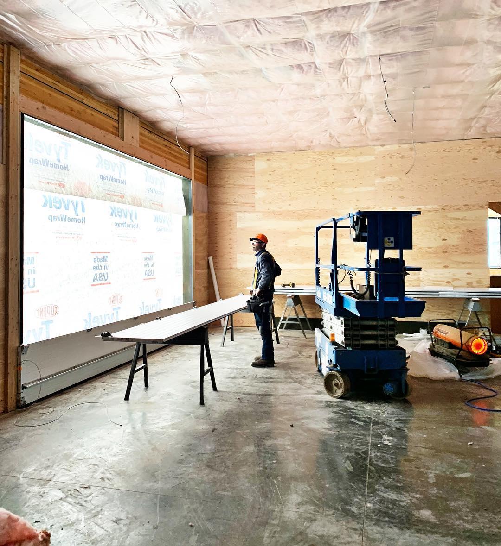 Garage door day...it's a big deal. We build houses around garage doors whitefish custom home builder