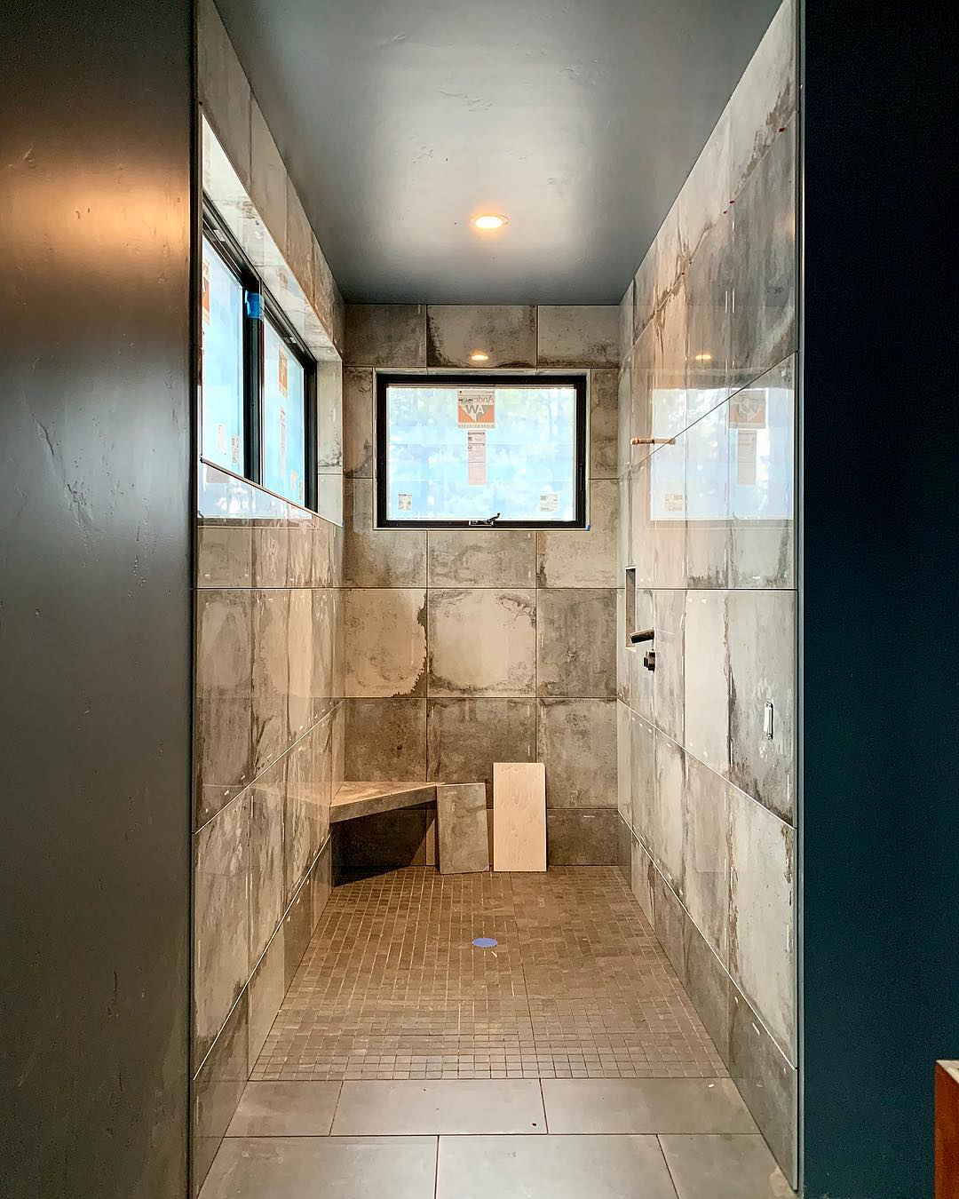 This master shower is absolutely stunning!!! whitefish custom home builder