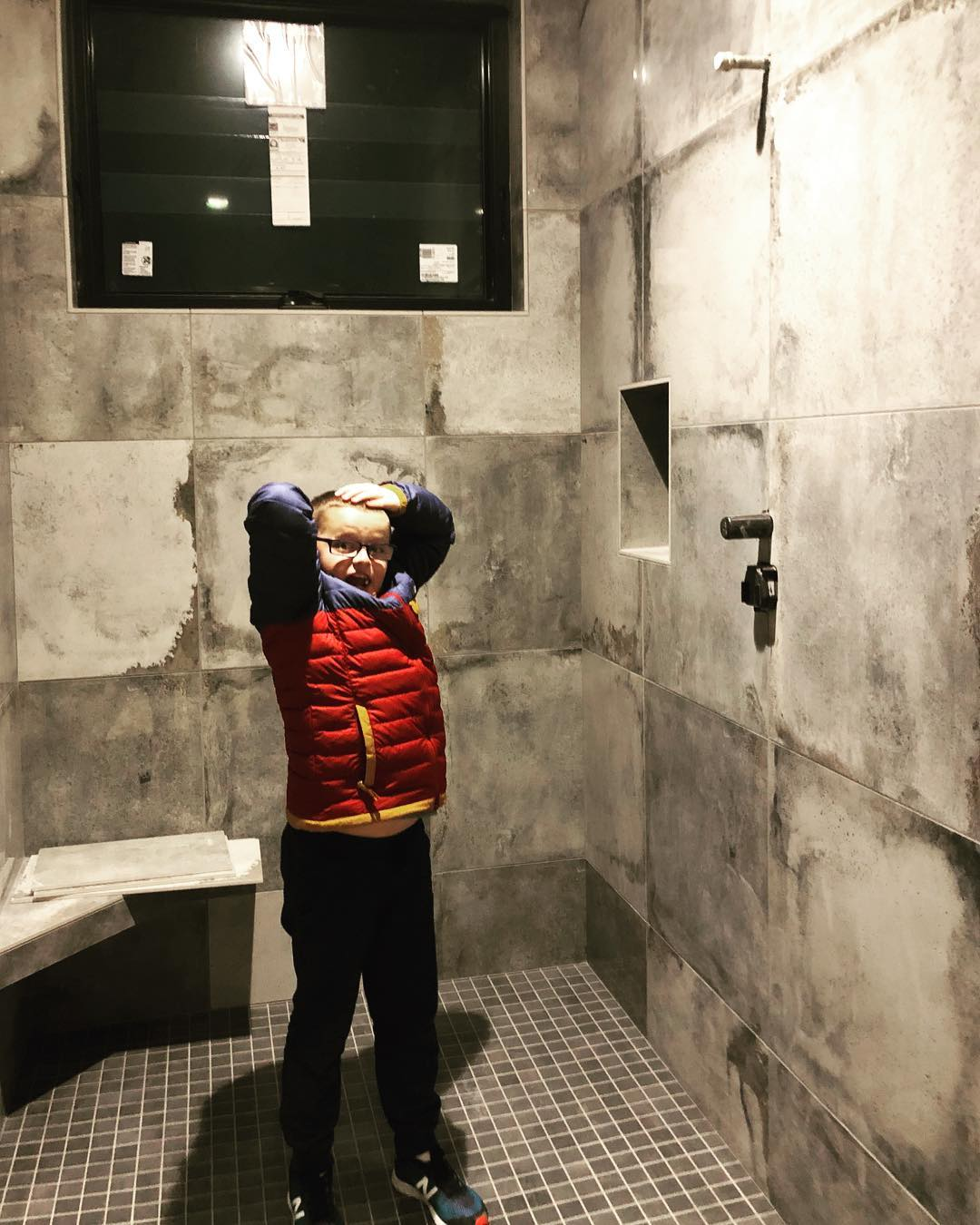 Testing out the world's biggest shower whitefish custom home builder