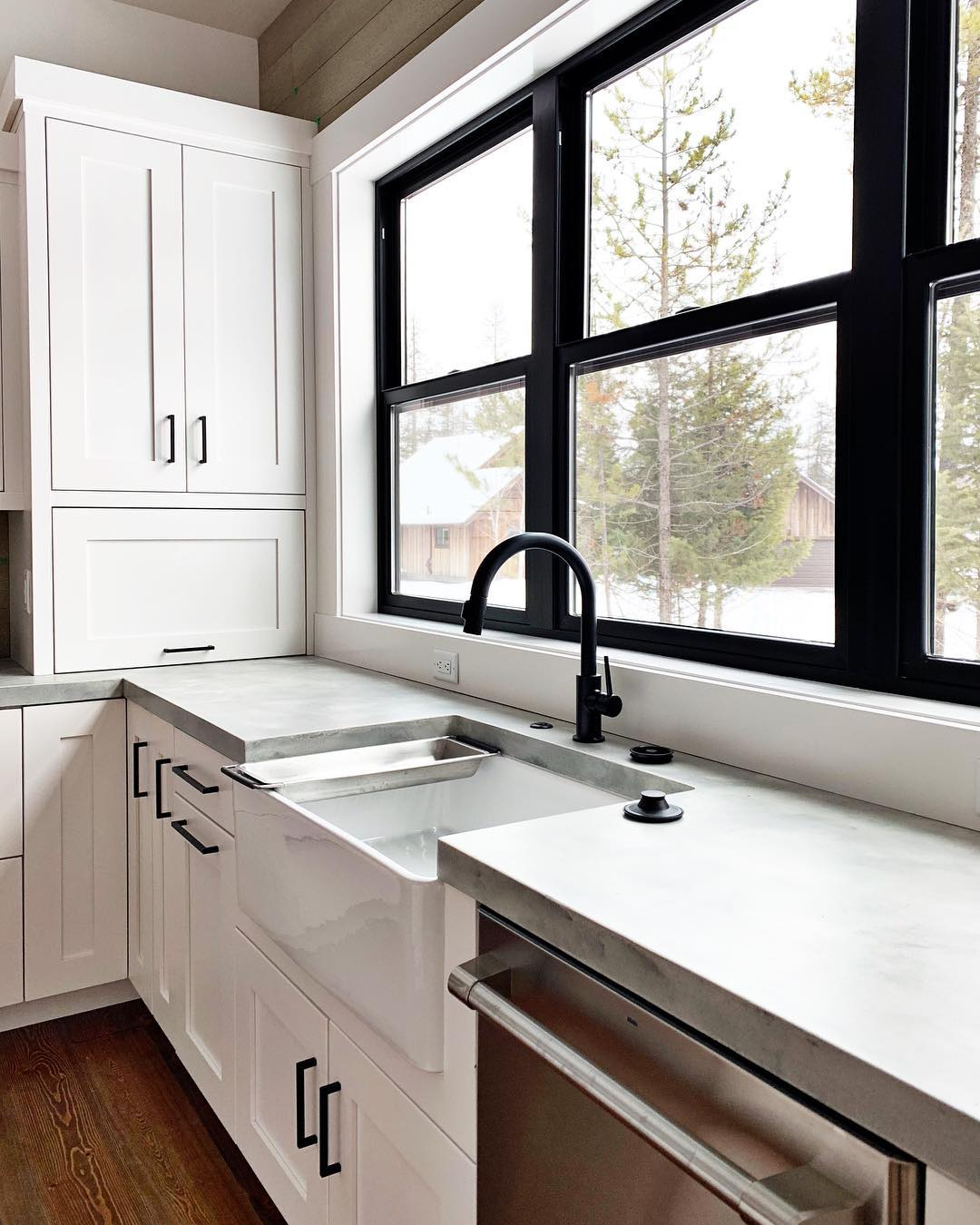 Modern farmhouse...don't you love those concrete countertops?? I have them in my own house and I've loved them ️ @awiwoodworks whitefish custom home builder