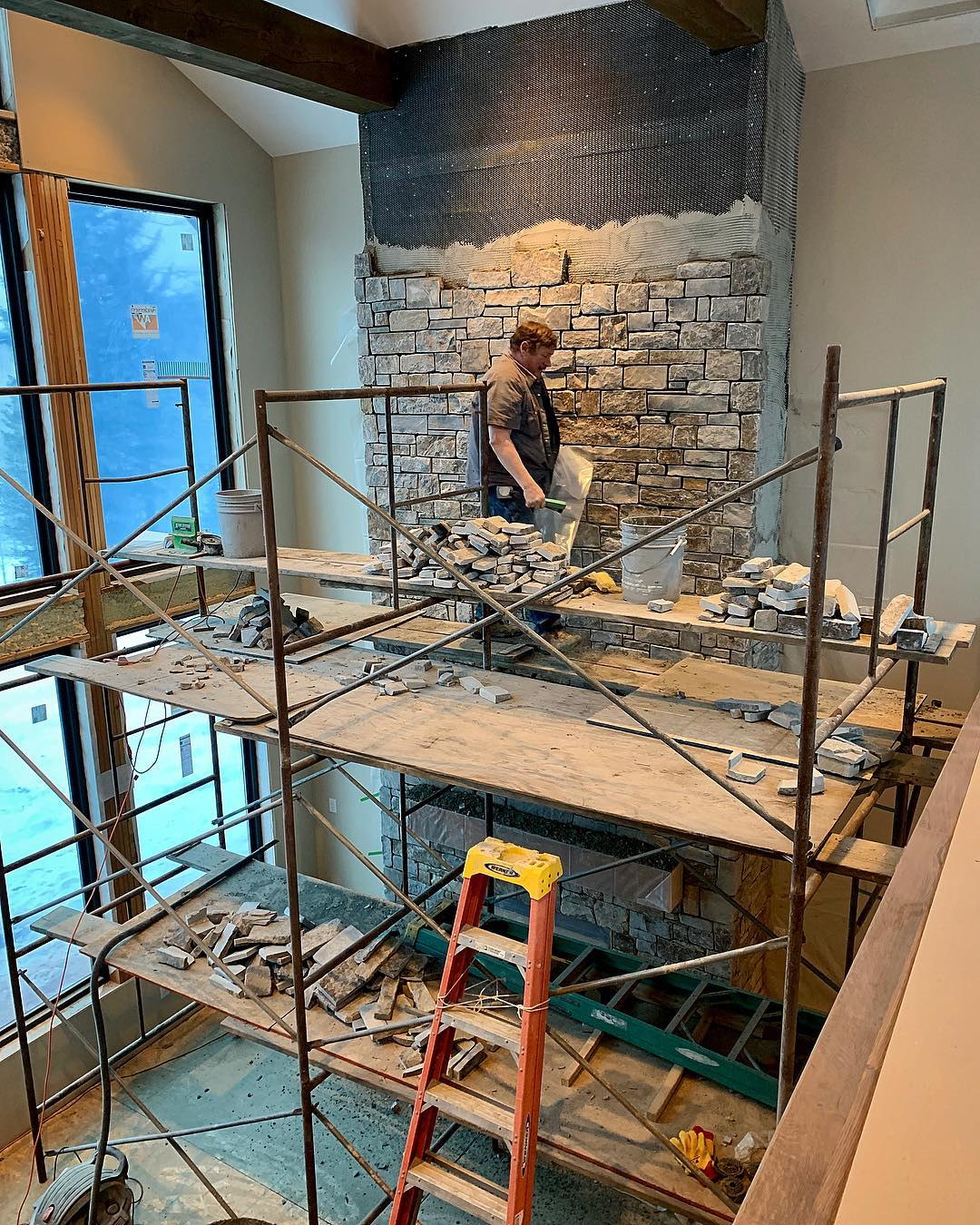 Closer to the top! About 26 feet of Montana rock getting stacked here. @montanarockworks whitefish custom home builder