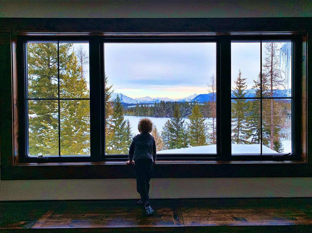 Looking for dinosaurs in the field below. These are absolutely my favorite photos sent to me after we finish a house  I love getting to be part of this!! whitefish custom home builder