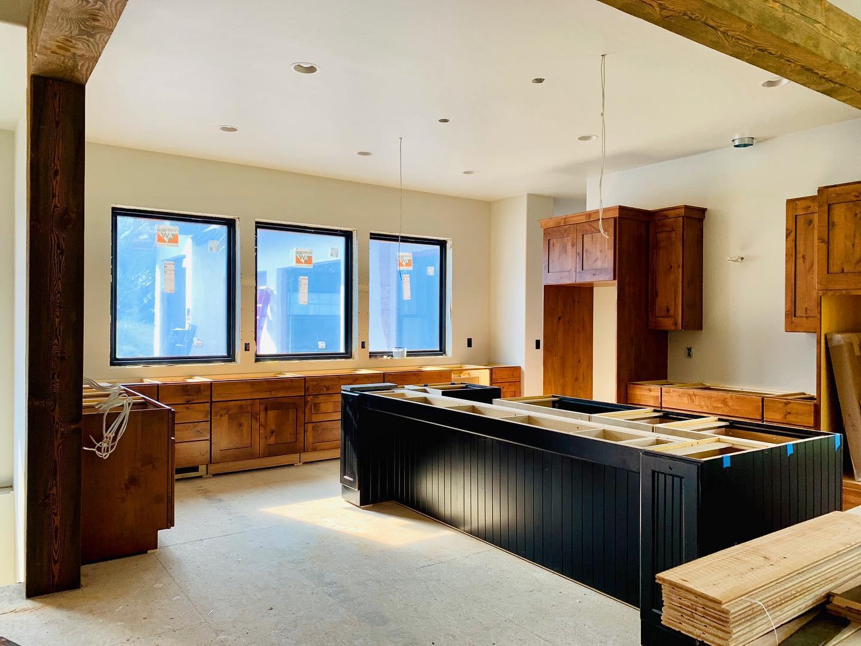 Furniture-like massive island! whitefish custom home builder