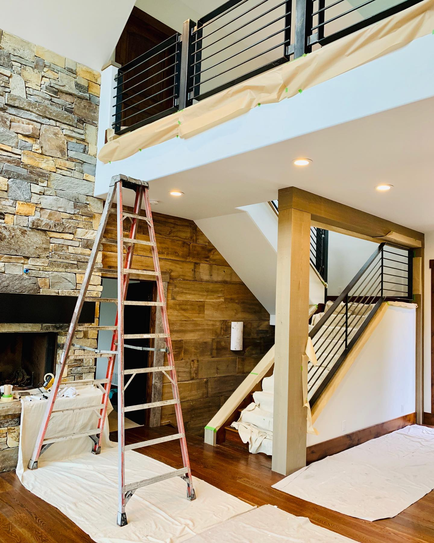 This railing looks so good!! I can't believe how much this space has changed! whitefish custom home builder