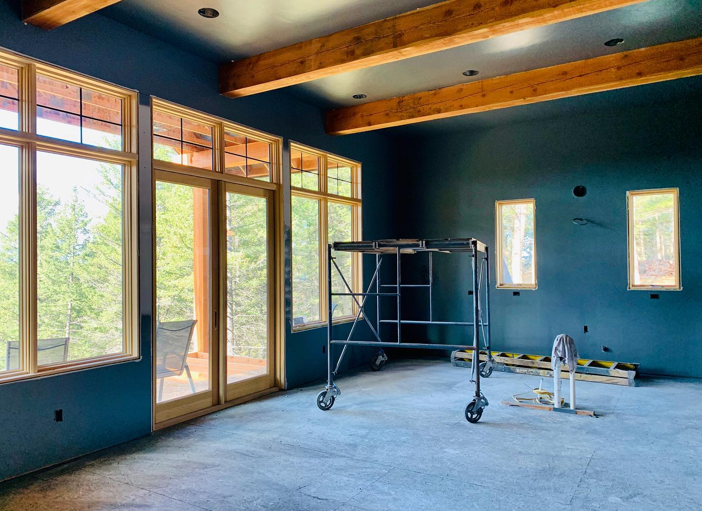 I'm loving this super rich color pallet. Going this dark in your main living space is bold, but it's going to set everything around it off like a work of art! whitefish custom home builder