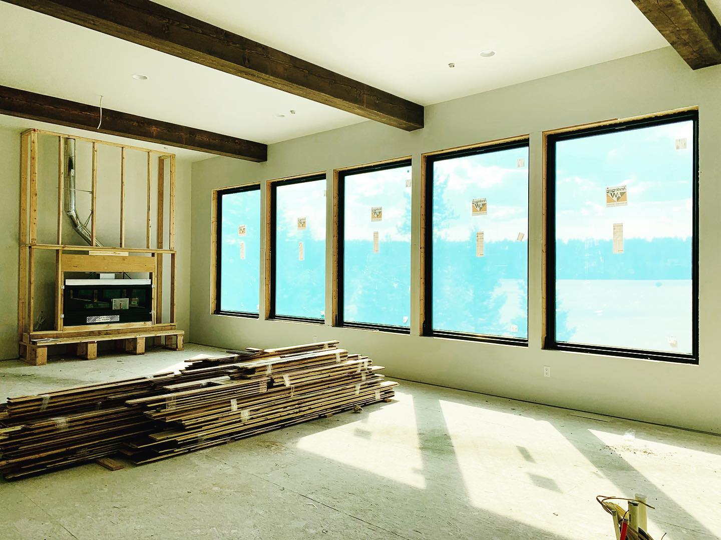 Spec house windows are fantastic. The cabinets and fireplace to come together next week!  295 Bowdrie Trail, Whitefish whitefish custom home builder