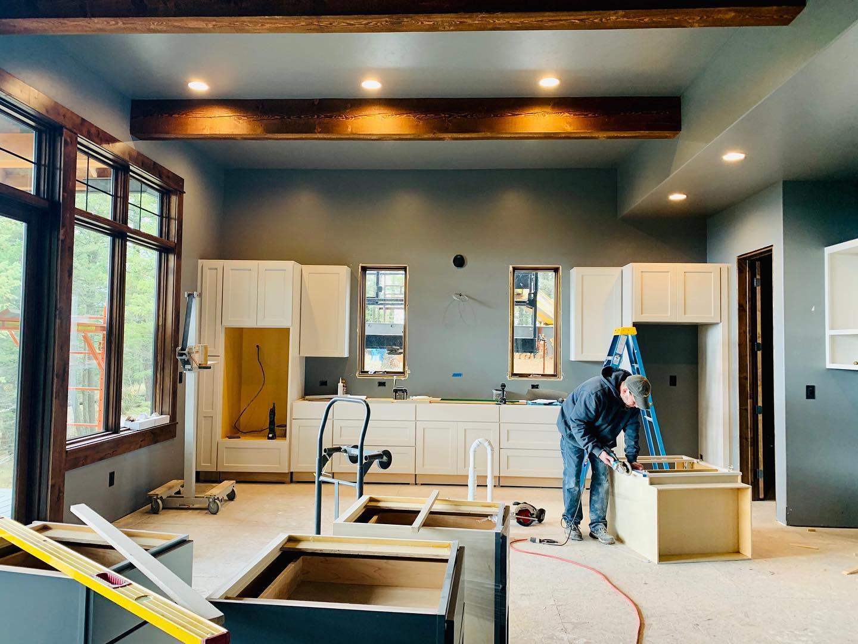 Cabinet setting time! whitefish custom home builder