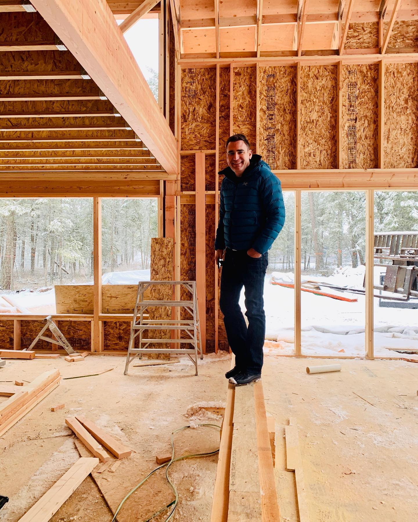 Walking the plank (or in this case just a big beam) whitefish custom home builder
