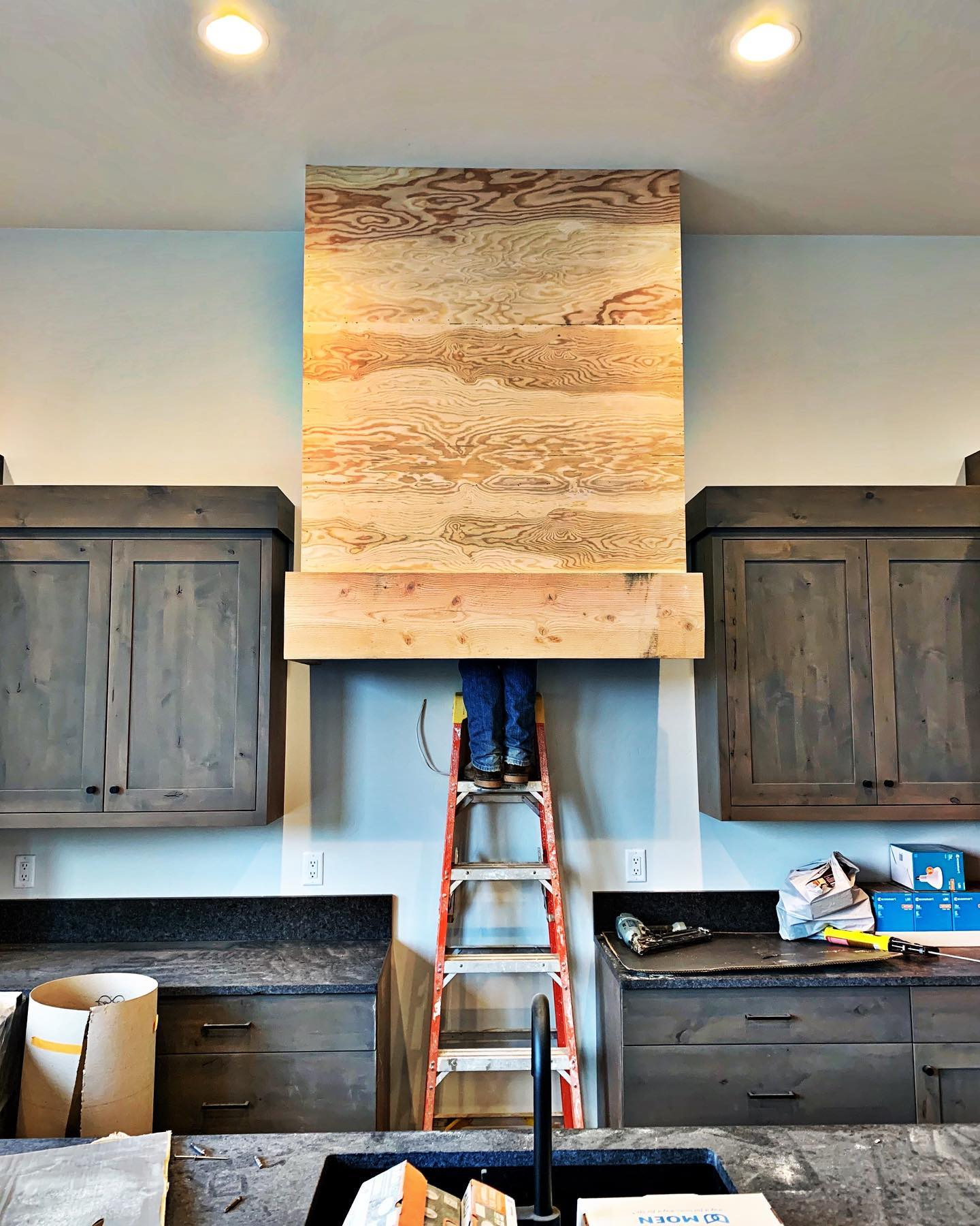 Yes, the hood is really that big (and now covered in dark gray shiplap!) @awiwoodworks whitefish custom home builder