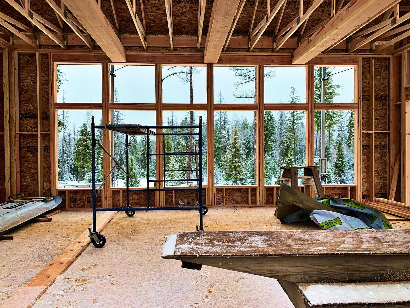 You can't see it today but there are fantastic Montana views through these windows. How much do you love this space?? whitefish custom home builder