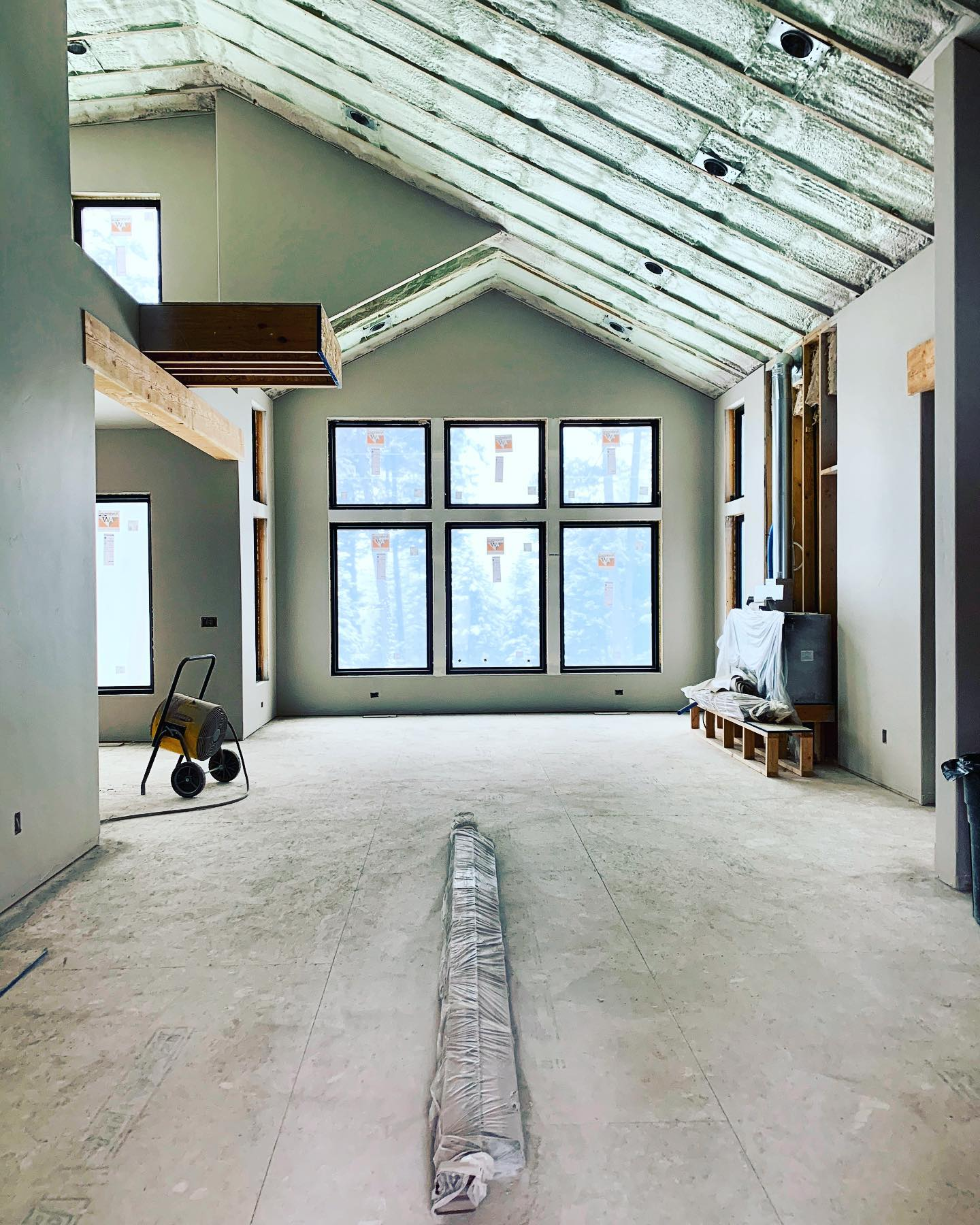 Color of the day...green. Not the wall color, but the lovely cast of the green-spray foam insulation  it's going to be a warm house!! whitefish custom home builder