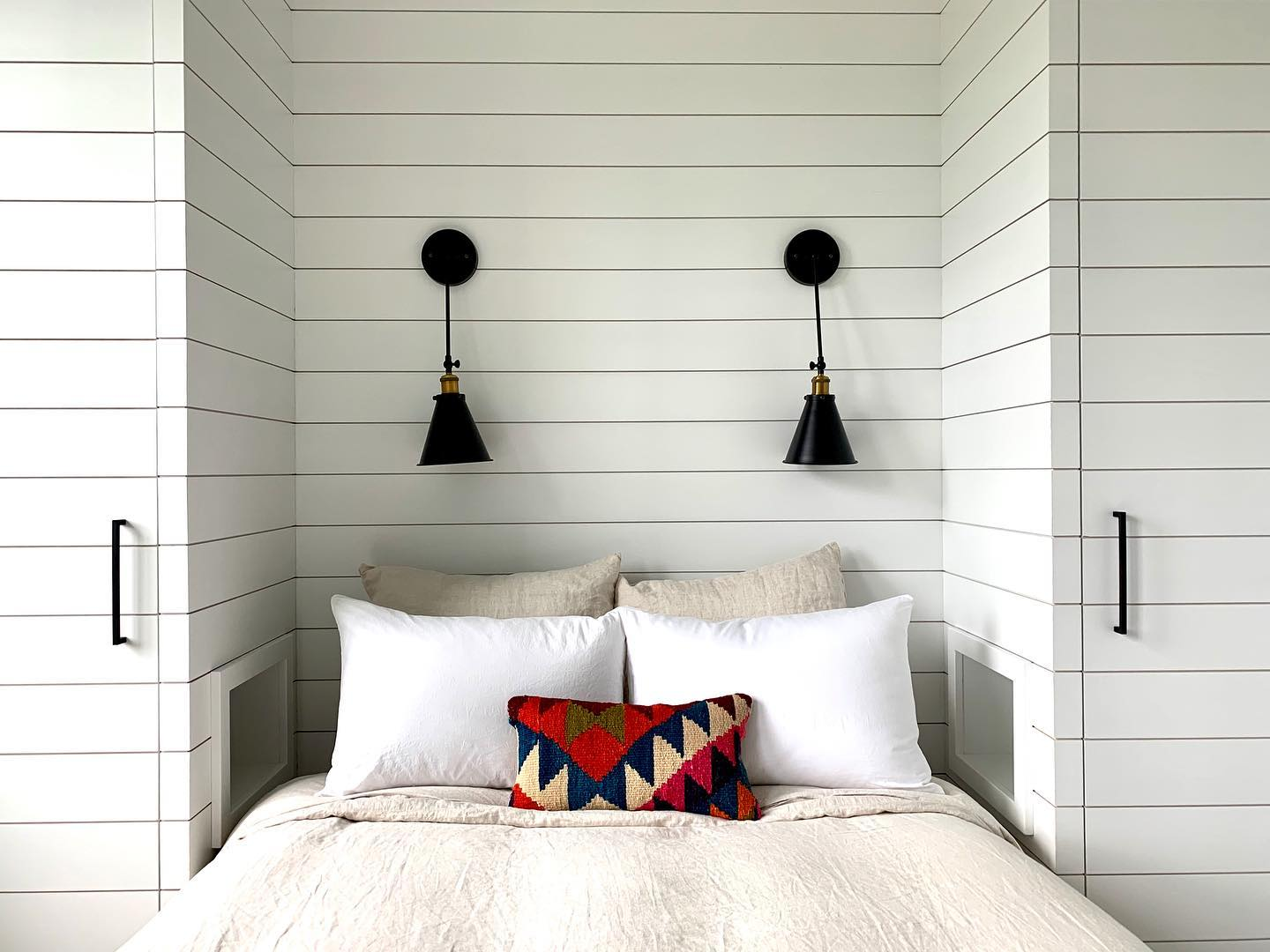 Shiplap, cubby books for your iPhone and water, reading light, built in his and hers closet...what more do you need?!? whitefish custom home builder