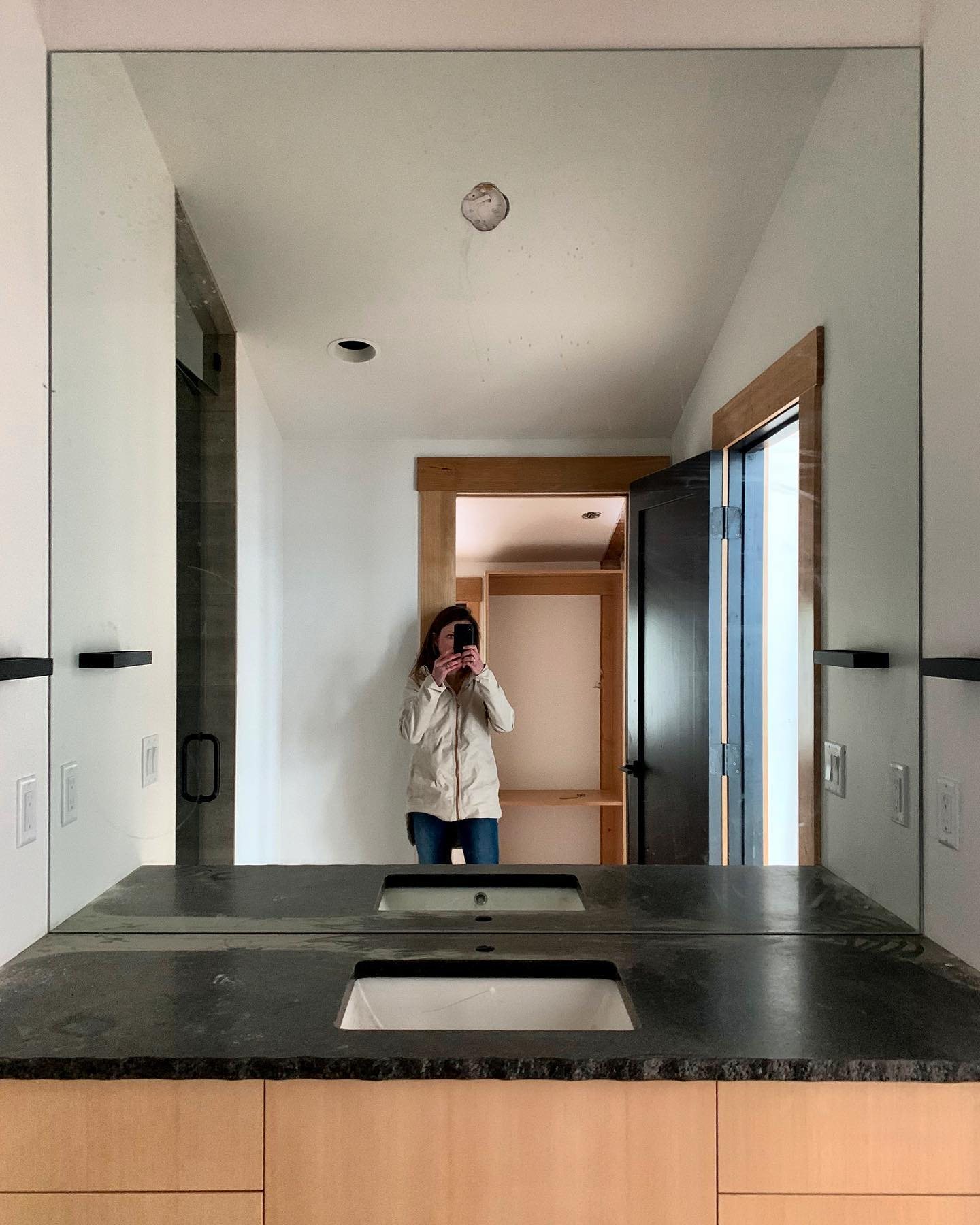 Another project coming together...just got this massive mirror up, now we can add the light! whitefish custom home builder