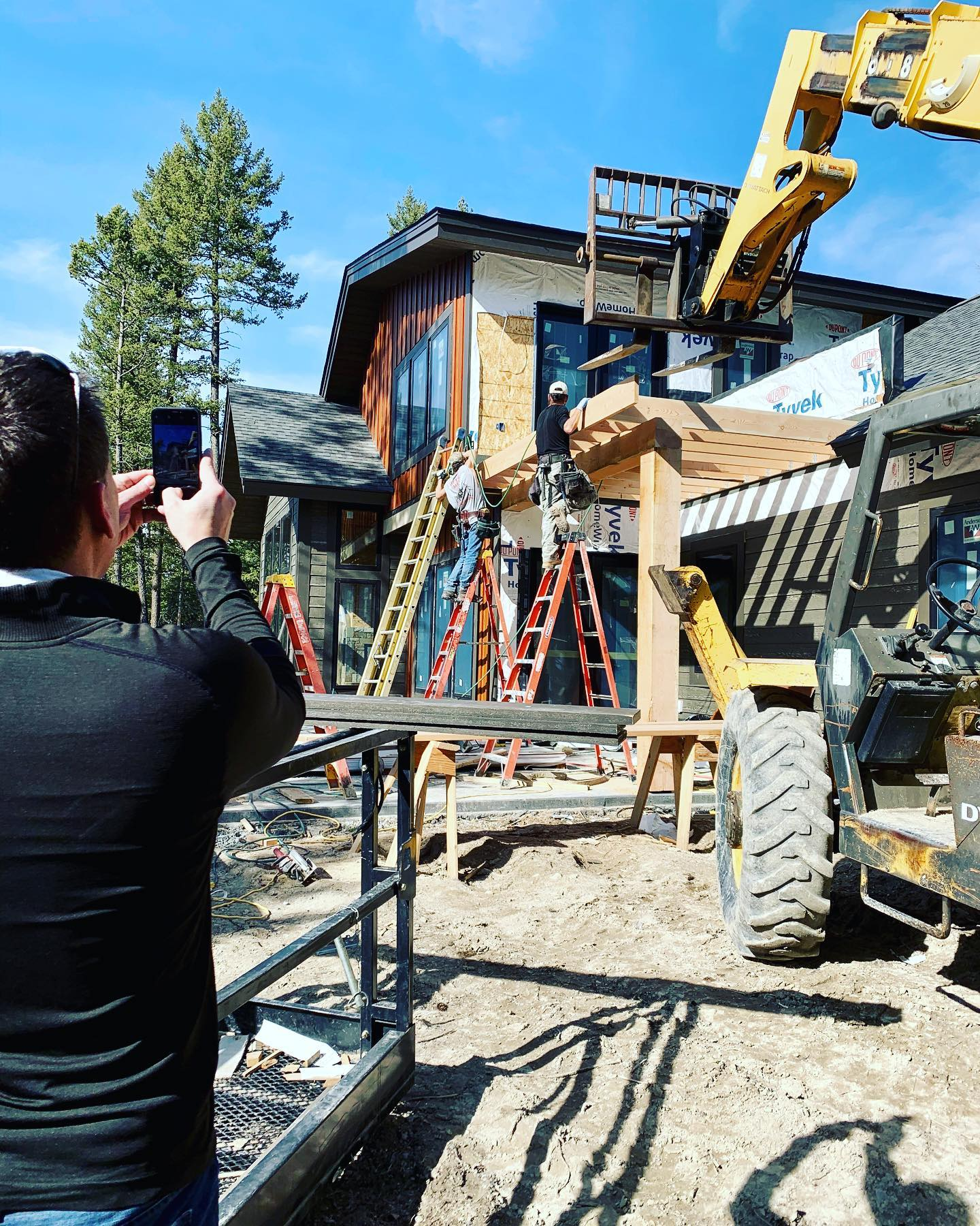 Finishing touches...on the home stretch with the deck just in time for tanning weather whitefish custom home builder
