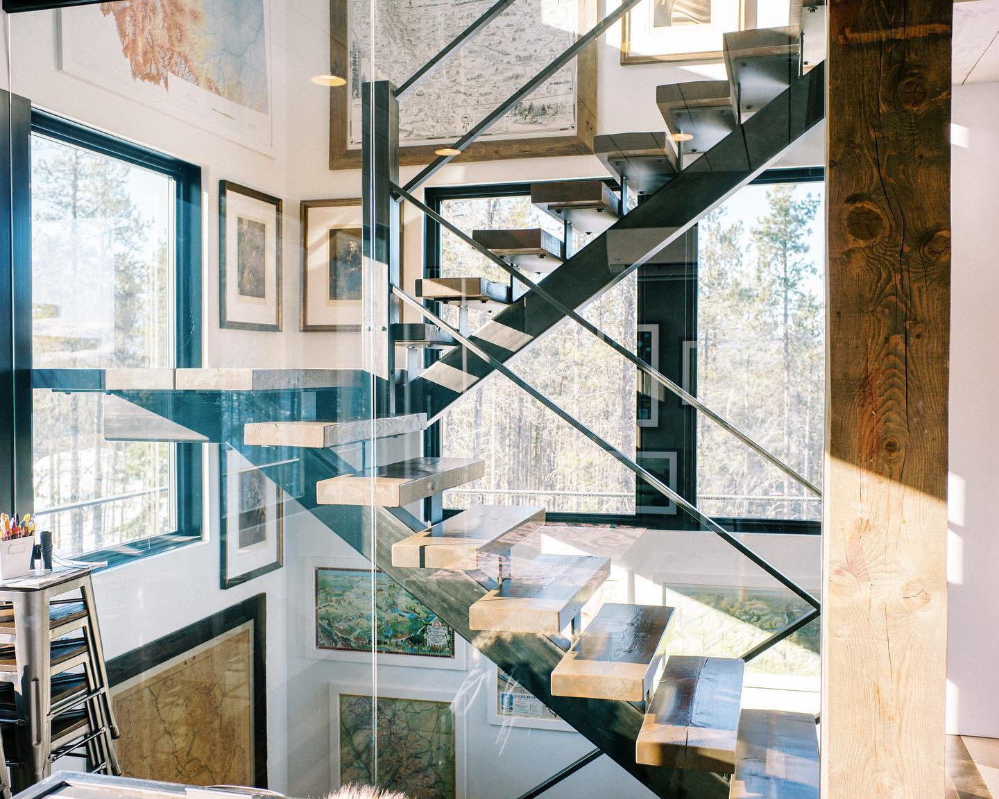 Suns out! Love these floating stairs...and the art is pretty good too!!  photo credit @jeremiahandrachel @frameref_whitefish whitefish custom home builder