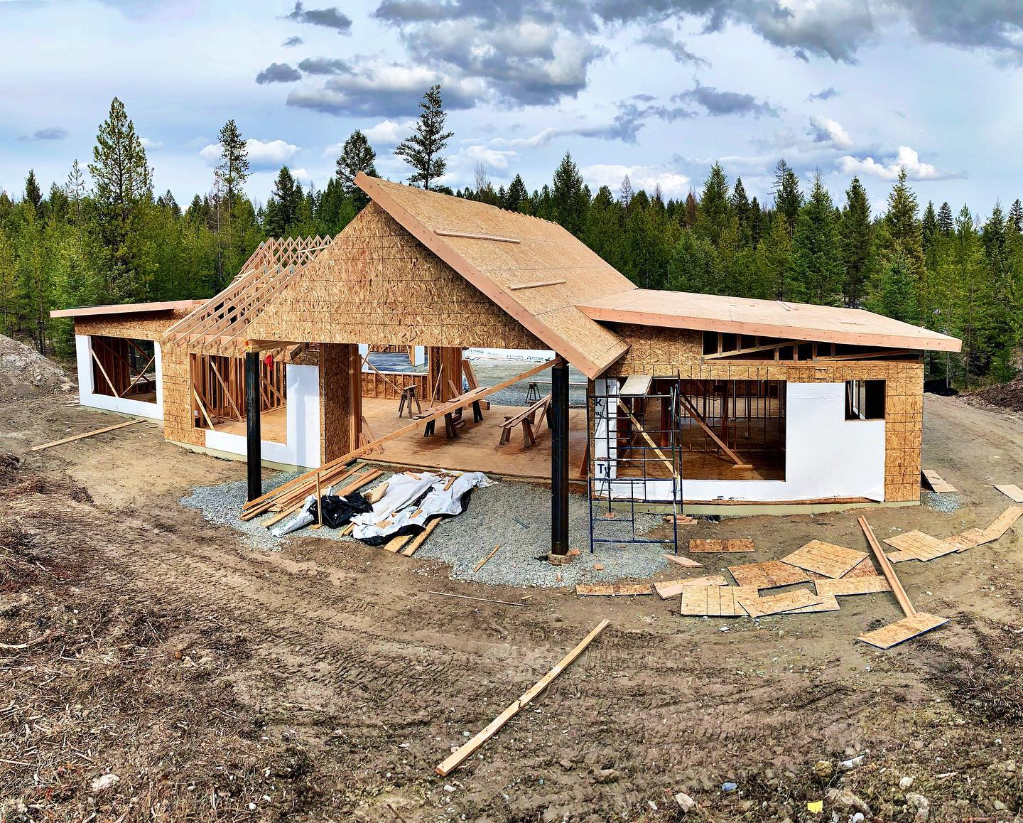 These roof lines and steel beams!!! whitefish custom home builder