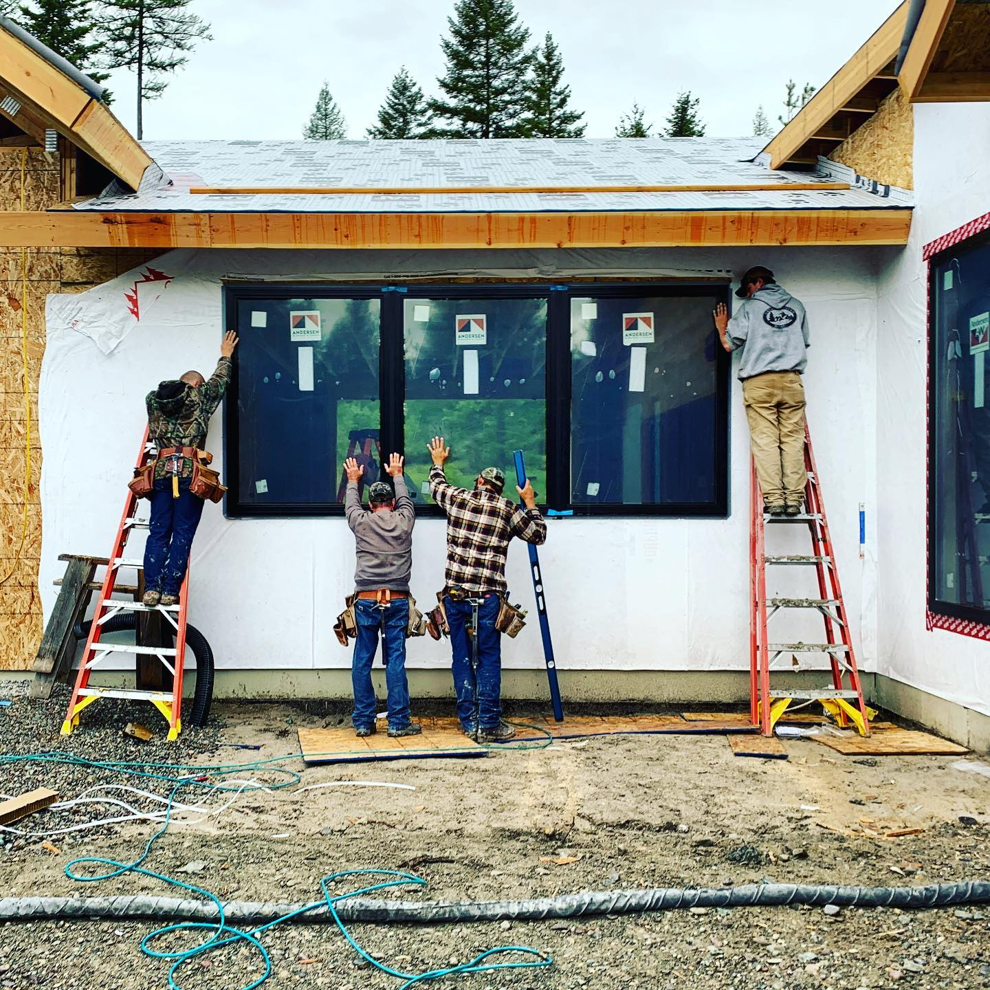 Have to love a crew who sets windows in the pouring rain... whitefish custom home builder