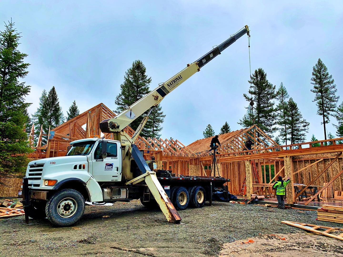 Pouring down rain but trusses still got set by our hardcore framers! whitefish custom home builder
